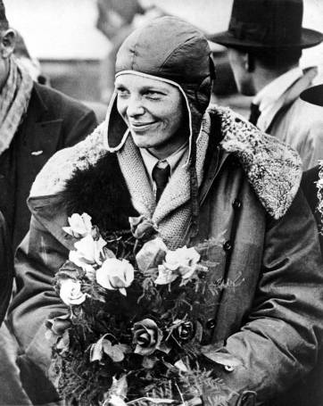 Amelia Earhart wearing a flying jacket